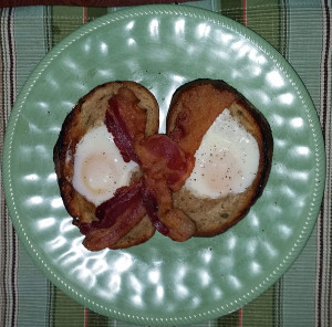 Egg in a hole with bacon strips