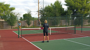 Donna serving on the Towerpoint pickleball court