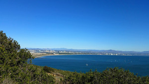 Pacific Ocean at the mouth of San Diego Bay - downtown San Diego on the east side of the bay is seen on the left, the strand is on the right of the photo