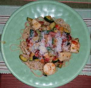 Spicy scallops with Zucchini and tomatoes