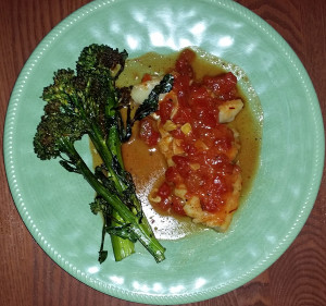 Wild Alaskan cod poached in tomatoes and saffron with roasted broccolini