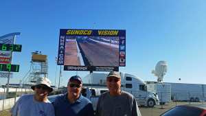 Mike, Pat and Leendert in front of the big screen at the finish line