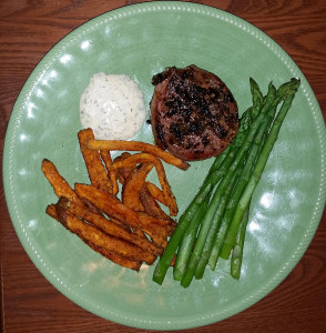 Bacon wrapped filet, spicy chipotle sweet potato fries with dipping sauce and asparagus