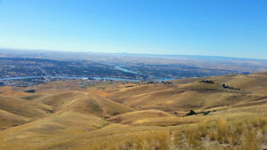 Clearwater River from left to right joins the Snake river, separating Lewiston, Idaho from Clarkston, Washington.